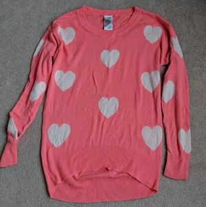 Pink sweater with white hearts